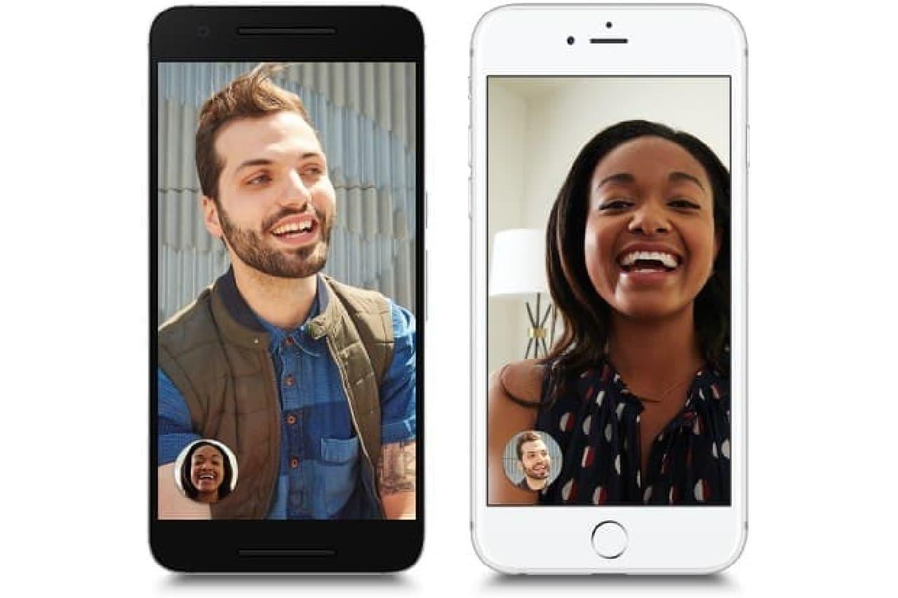 スマートフォンに映った白人男性と黒人女性