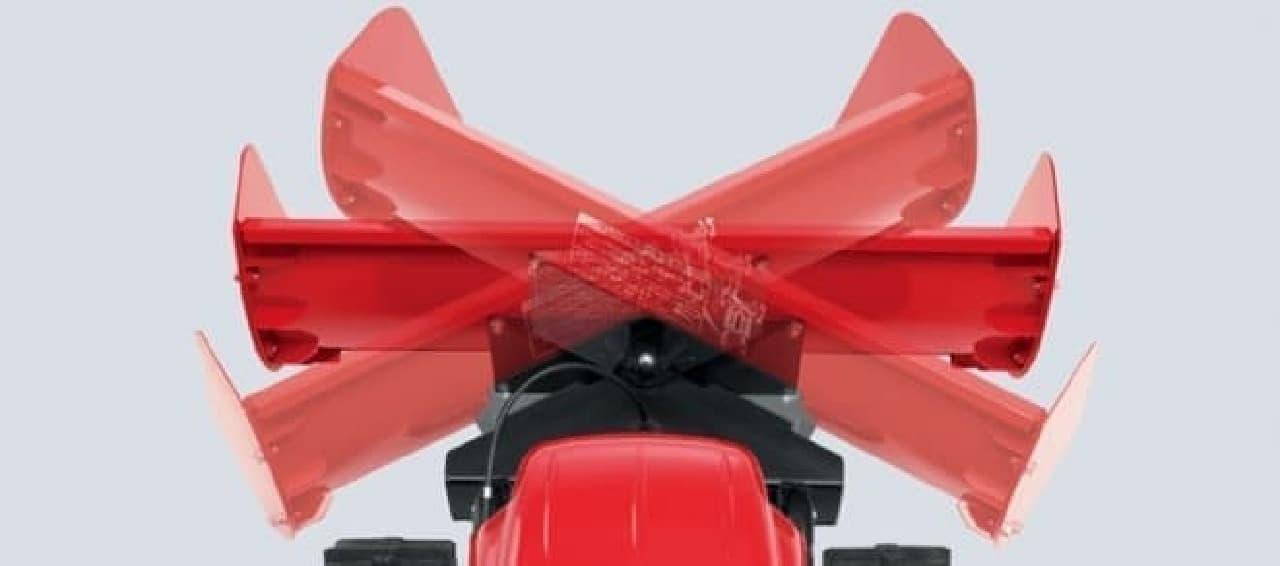 雪を飛ばして除雪するロータリー除雪機