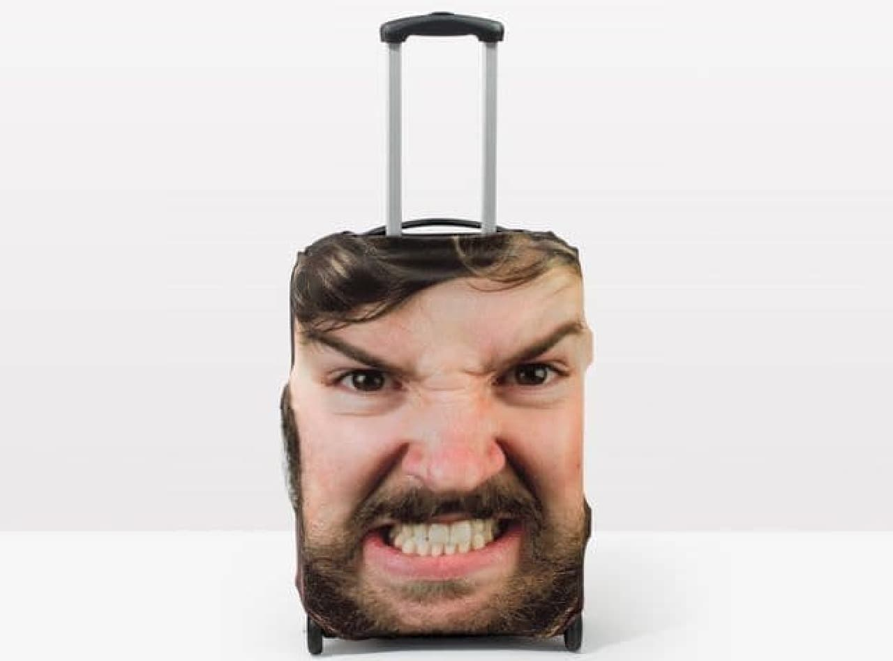 顔写真をスーツケースカバーにする「HEAD CASE」